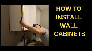 how to install base cabinets in laundry room how to install wall cabinets in a laundry room