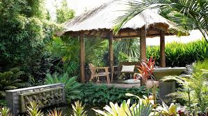 cozy bamboo gazeboo in the middle of a balinese style front yard