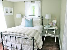 simple chic small bedroom decorating using black iron bed frames
