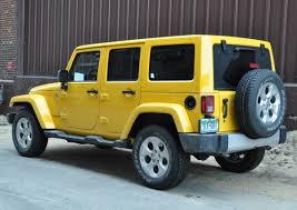yellow jeep capsule review 2015 jeep wrangler unlimited sahara the truth