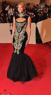 met gala 2011 beyonce and rihanna turn heads in dramatic gowns