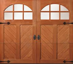 fatezzi faux wood garage doors these custom made spanish style garage doors feature a beautiful