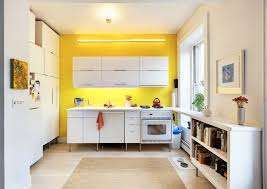 kitchen bright yellow white accent wall simple cabinet for storage