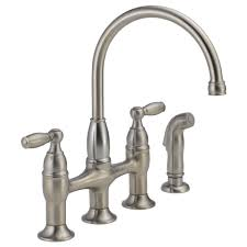 kitchen bridge faucet two handle bridge kitchen faucet with spray 21966lf ss delta faucet