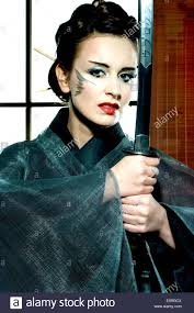 japanesse women with grey hair beautiful japanese grey kimono woman with samurai sword in stock