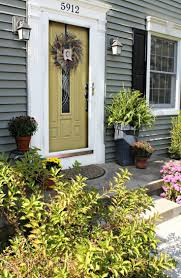 how we boosted our curb appeal with a yellow front door