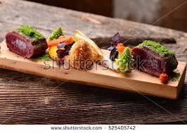 cuisine steak dining venison steak vegetable ภาพสต อก 525405742
