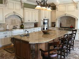 classy white interior custom kitchen cabinets with big dining set