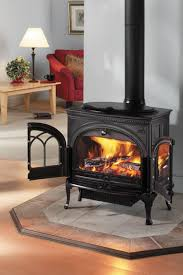 Living Rooms With Wood Burning Stoves Furniture F 600 Firelight Cb Jotul Wood Stove Fireplaces In Tile