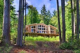 At Home Vacation Rentals - hood canal quilcene house rental looking back at home from fire