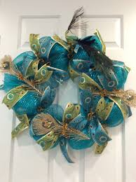 peacock wreath made with turquoise mesh and peacock ribbon from