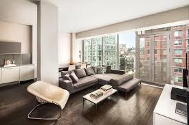 modern living room with hardwood floors u0026 columns zillow digs