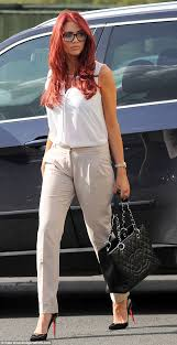 amy childs puts on a brave face as she steps out for first time