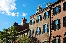 Row Houses by Old Boston Row Houses And Brownstones On A Sunny Afternoon In
