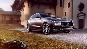 matte orange maserati tuned maserati levante gets huge wheels carbon body parts more power