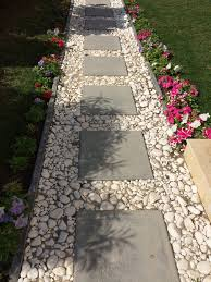 Backyard Walkway Ideas Cement Block Tiles Bordered By White Pebbles For A Simple Pathway