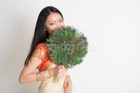 peacock feather fan with peacock feather fan in indian sari dress stock photo