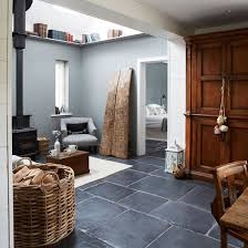 country home and interiors rustic living room with wood burner and slate floor west sussex