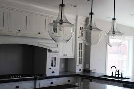 wall mounted pendant light pendant lighting over kitchen sink gray granite countertop wall