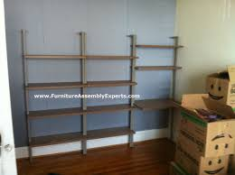 cb2 helix taupe bookcase and desk assembled in washington dc by