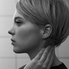 short hairstyle worn beind the ears in layers for fine hair blow dry straighten and tuck the longest layer behind the ear