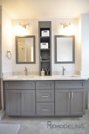 bathroom double wall mirror with wall lamps and wall shelves plus