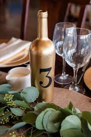 gold wine bottle table numbers early spring stone tower winery wedding united with love amber