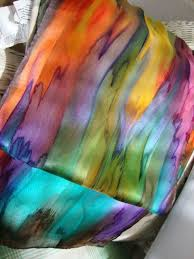 this gorgeous multi colored streaked scarf is hand painted and is