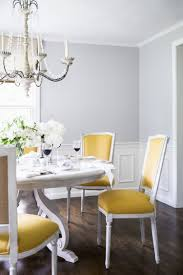 Yellow Chairs Pop Against Gray Dining Room Walls WALL PAINT - Dining room walls