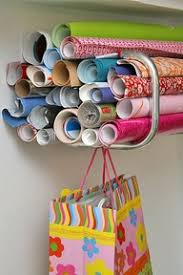 how to store wrapping paper and gift bags wrapping paper organization the joyful organizer