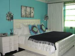 beautiful bedroom design with turquoise wall paint and white