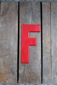 vintage metal letter f red painted sign by theoldtimejunkshop