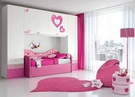 pink and white girls bedroom ideas wooden bed connected with