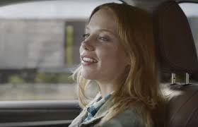 actress in subaru commercial 2016 crosstrek who is the red haired woman riding the train in subaru s boxcar