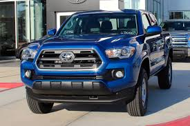 blue nissan truck 2016 toyota tacoma vs nissan frontier toyota truck shopping