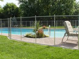 landscaping around the pool love the self closing locking gate