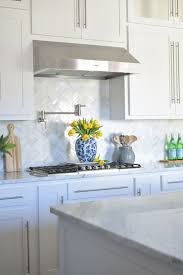sink faucet kitchen backsplash with white cabinets mosaic tile