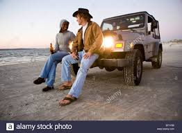 jeep beer tire cover couple drinking beer beach stock photos u0026 couple drinking beer