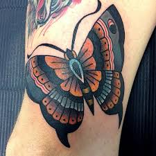 lovely traditional butterfly by dap skingdom tattoos