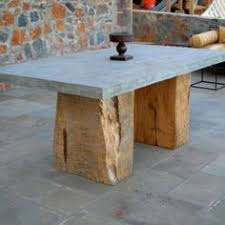 concrete and wood outdoor table the cement table tops are held up by fenced in logs i designed for a