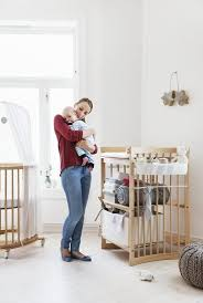 white mini crib with changing table scandinavian designed nursery in natural wood stokke mini crib and