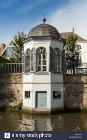 white octagonal summer house by the groenerei canal bruges