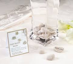 guest signing stones in a vase guestbooks and pens wedding