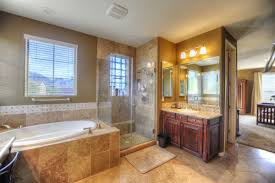 lavish master bathroom with soaking tub shower and travertine