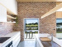 how to hang kitchen cabinets on brick wall best 24 modern kitchen brick backsplashes white cabinets