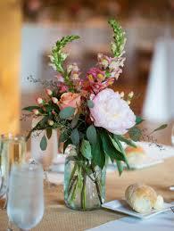 jar arrangements wedding flower centerpiece colorful flowers in blue jar1 jar