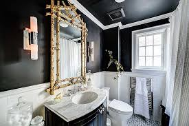 modern retro bathroom idea in black and white with pops of gold
