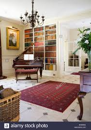 red oriental rug on cream black tiled floor in country hall with
