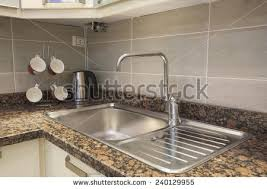 Kitchen Sink Stock Images RoyaltyFree Images  Vectors - Kitchens sinks and taps