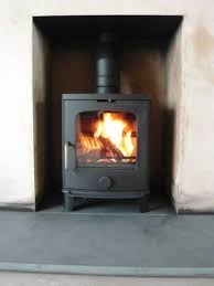 scan andersen woodburner in a newly plastered fireplace wood
